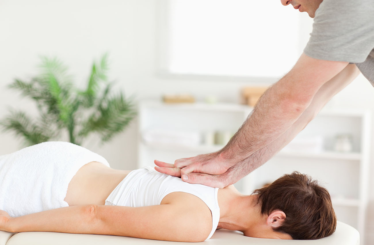 woman getting chiropractic back pain treatment